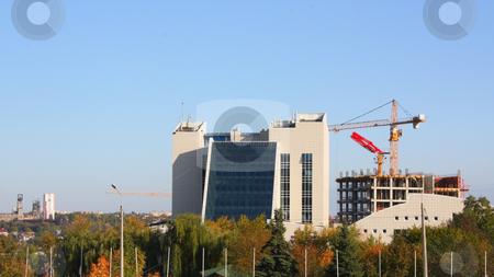 Construction of hotel stock photo, Construction of hotel near a new building by Valerij Kotulskij