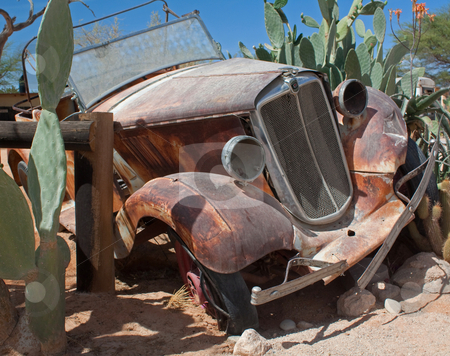 Rusty car stock photo, A rusty car in Namibia;