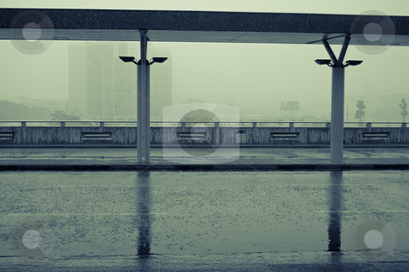 Rainy day in the city airport stock photo, Heavy tropical rain and empty Asian airport parking by Pavel Filippov