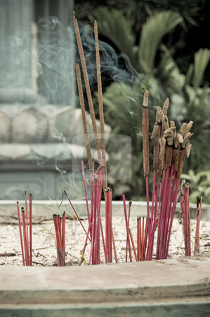 Burning incense in urn at buddhist pagoda stock photo, Bunch of incense sticks burning near vietnameese temple by Pavel Filippov