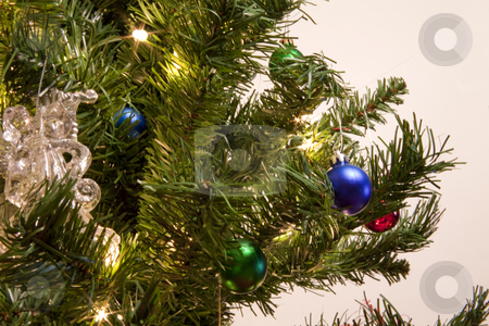 Christmas tree with ornaments stock photo, A christmas tree with ornaments by Jared Davidson