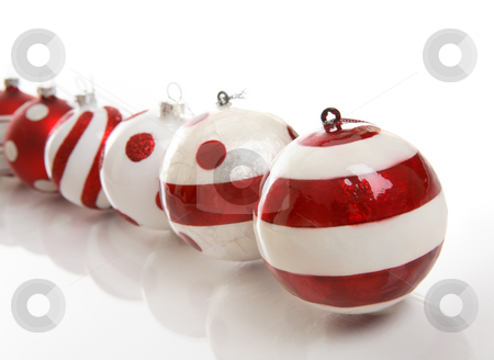 Christmas Baubles stock photo, A selection of red and white Christmas baubles on a white background.  Focus is to first bauble.  Space for copy. by Leah-Anne Thompson
