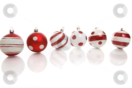 Christmas bauble decorations stock photo, Red and white Christmas baubles on a white background with space for copy. by Leah-Anne Thompson