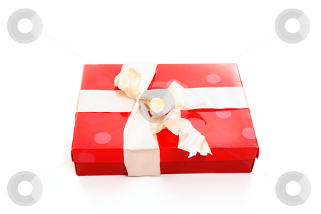 Red box tied with cream ribbon bow stock photo, Red box tied up with cream wired satin ribbon by Leah-Anne Thompson