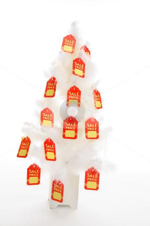 Christmas Sales stock photo, Red and yellow sale tags hang from a white Christmas tree. concept.  Change it to suit your needs. by Leah-Anne Thompson