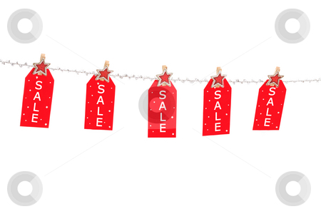 Christmas Sale stock photo, Pre or post Christmas sale -  tags on a silver glitter string line with fancy pegs with stars.  Or change it to add your own text by Leah-Anne Thompson