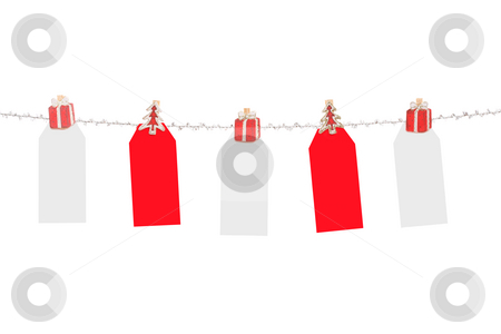 Christmas tags stock photo, Blank red and white Christmas tags hanging from silver line.  Ready for a message by Leah-Anne Thompson