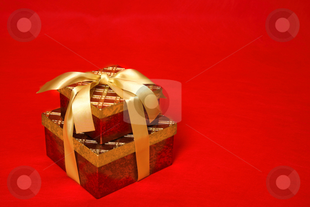 Gift Boxes stock photo, Gift boxes tied up with gold satin ribbon for Christmas, a birthday or other special occasion by Leah-Anne Thompson