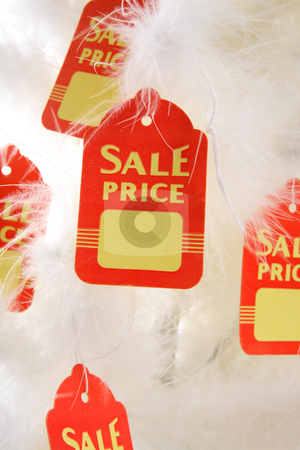 Christmas Sale or Discount stock photo, Sale tags hang from white Chirstmas tree by Leah-Anne Thompson