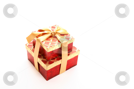 Red gold gift stock photo, Red and metallic gold gift tield with satin ribbon on white background. by Leah-Anne Thompson