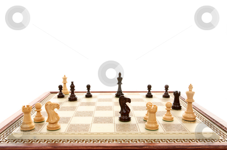 Checkmate stock photo, Black mates white.  Focus to white king. by Leah-Anne Thompson