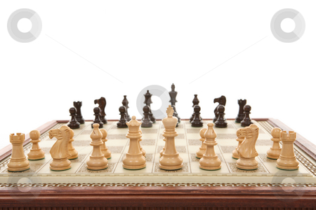 Chess game stock photo, A carved marble chess board and wooden chess pieces.  Focus to foreground. by Leah-Anne Thompson