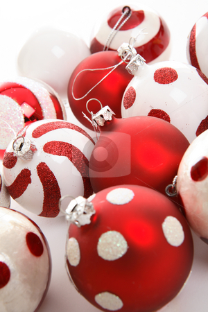 Festive Christmas Balls stock photo, Various Christmas baublesin red and white theme colours sit  on a white background.  Focus to centre balls. by Leah-Anne Thompson
