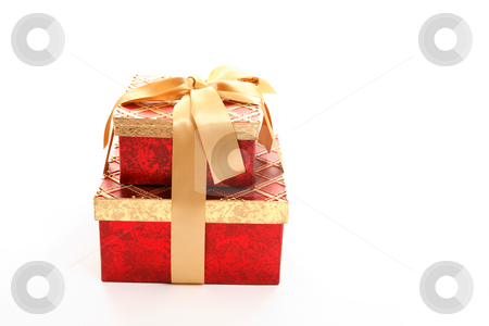 Red and gold gift boxes stock photo, Red and gold giftboxes tied up with ribbon  on white. by Leah-Anne Thompson