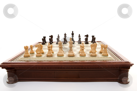 Chess board and chess pieces stock photo, A chess gameboard with playing pieces ready. . Each player has 16 playing pieces and white always plays first. by Leah-Anne Thompson