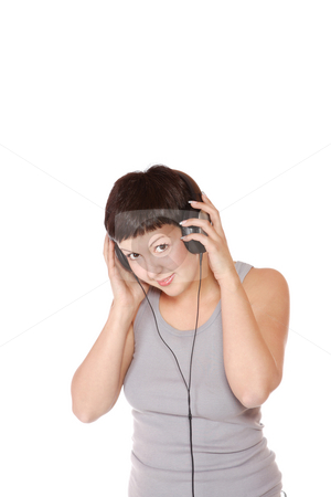 Listening to Music stock photo, Beautiful young woman  Listening to Music by Remy Musser