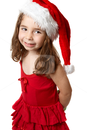 Smiling girl in red santa hat stock photo, Little girl wearing a red dress and a red santa hat by Leah-Anne Thompson