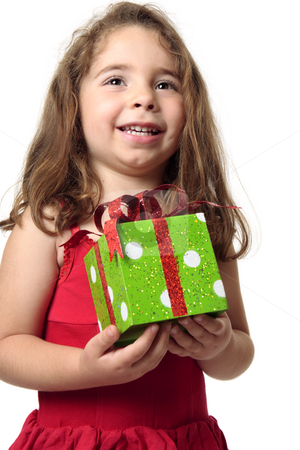 Excited girl holding a present stock photo, Exuberant happy child holding a present. by Leah-Anne Thompson