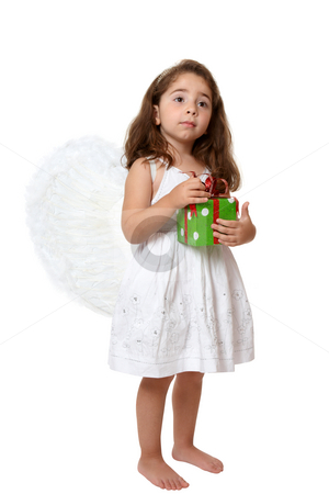Angel child holding a present stock photo, Angel girl wearing white embroidered dress and feathered wings is holding a red and green Christmas or brithday  present. by Leah-Anne Thompson
