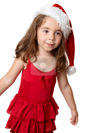 Child wearing a red Santa hat stock photo, Prety girl wearing a red dress and red santa hat at Christmas by Leah-Anne Thompson