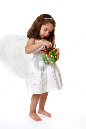 Angel  child with Christmas present stock photo, Angel or fairy with Christmas present by Leah-Anne Thompson