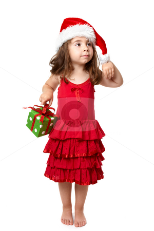 Little girl with Christmas present stock photo, Little girl wearing a red dress carries a present by Leah-Anne Thompson