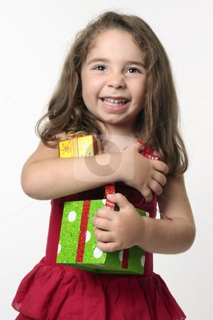 Jovial happy girl child holding presents stock photo, Pretty young girl in a red dress, is holding presents and giggling with excitement and  happiness. by Leah-Anne Thompson