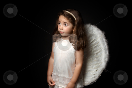 Pretty little angel looking sideways stock photo, Angelic little girl looking sideways with space for copy. by Leah-Anne Thompson