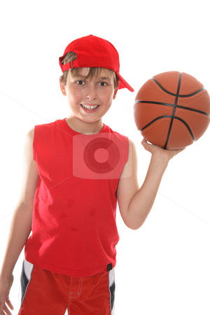 Happy child holding basketball stock photo, Hot, smiling child holding a basketball in one hand after play. by Leah-Anne Thompson