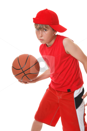 Basketball player stock photo, A boy playing with a basketball. by Leah-Anne Thompson