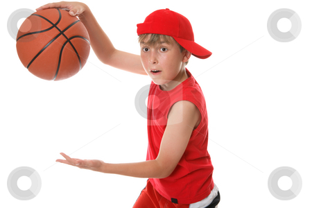 Playing basketball stock photo, A child in action playing a game of basketball by Leah-Anne Thompson