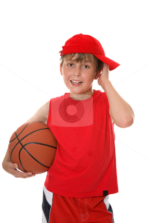 Basketball player stock photo, Flushed child holding a basketball aftera game. by Leah-Anne Thompson