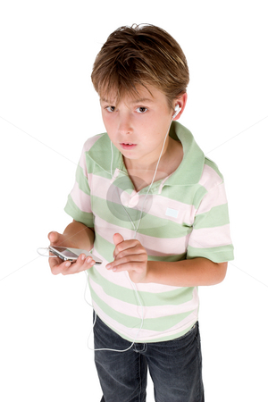 Boy holding mp3 player stock photo, A child dressed in jeans and polo shirt holding an mp3 player. by Leah-Anne Thompson