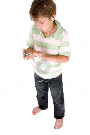 Child using audio device stock photo, Standing young child using a music mp3 player by Leah-Anne Thompson