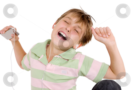 Child grooving to music stock photo, A child enjoying music on an mp3 player by Leah-Anne Thompson