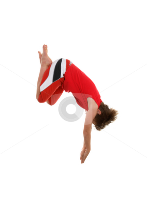 Dive headfirst stock photo, A boy dives  Some motion in fingertips and in the hair.. by Leah-Anne Thompson