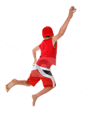 Jump for Joy stock photo, Boy jumps hand raised  in the air.  Jump for joy, leap of faith, etc, fitness, fun or concept.  There is a little bit of motion in the arm and feet at full size.. by Leah-Anne Thompson