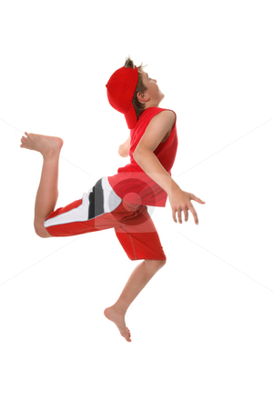 Get active stock photo, Boy running and leaping or reaching the finish line..  Some motion in fingers. by Leah-Anne Thompson