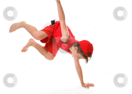 Active boy stock photo, Active boy moving  on one hand and legs in the air by Leah-Anne Thompson
