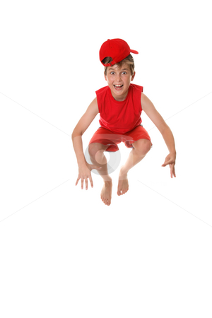 Happy crazy  jumping boy stock photo, A happy boy jumps up and down for fun by Leah-Anne Thompson