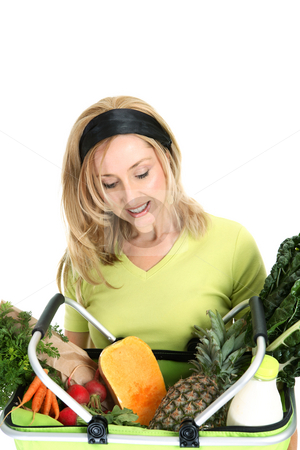 Woman with basket of food stock photo, A female holds a shopping bag filled with fresh fruit, vegetables, milk and bread by Leah-Anne Thompson