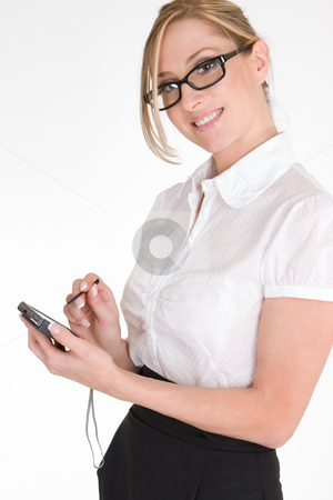 Working woman stock photo, Everything at your fingertips.  Woman at work using a pda. by Leah-Anne Thompson