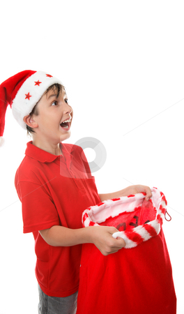 Sack full of presents stock photo, Boy with an open sack and looking up with  a gleeful expression.  Space for copy. by Leah-Anne Thompson