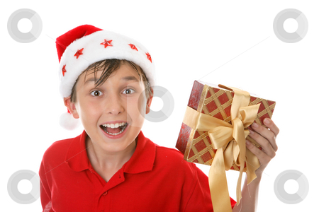 Exuberant child with Christmas gift stock photo, Excited jovial child holds a Christmas gift. by Leah-Anne Thompson