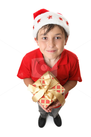 Christmas gift time stock photo, A child lookign up and holding a red and gold gift by Leah-Anne Thompson
