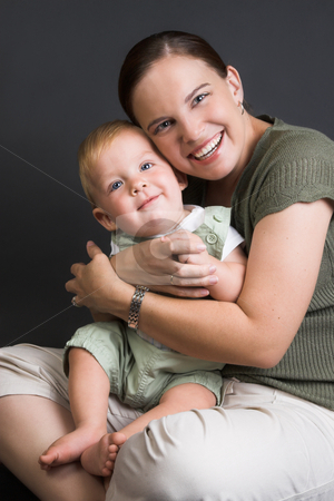 Mom and Baby stock photo, Smiling Mother and Baby on a black background by Carla Booysen