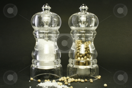 Pepper and salt stock photo, Salt and pepper against a black background by Marina Magri