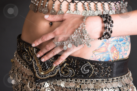 Belly Dancer Body stock photo, Belly Dancer with coin decorated costume and jewelery by Carla Booysen