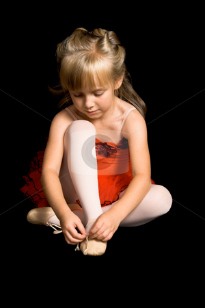 Tiny Ballerina stock photo, Young ballet dancer wearing a red costume by Carla Booysen