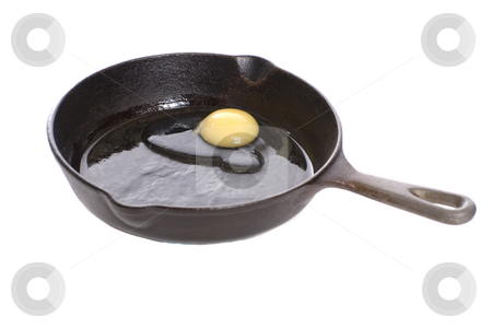 Frying Chicken Egg stock photo, A black cast iron pan with a fresh chicken egg about to be fried, isolated against a white background by Richard Nelson